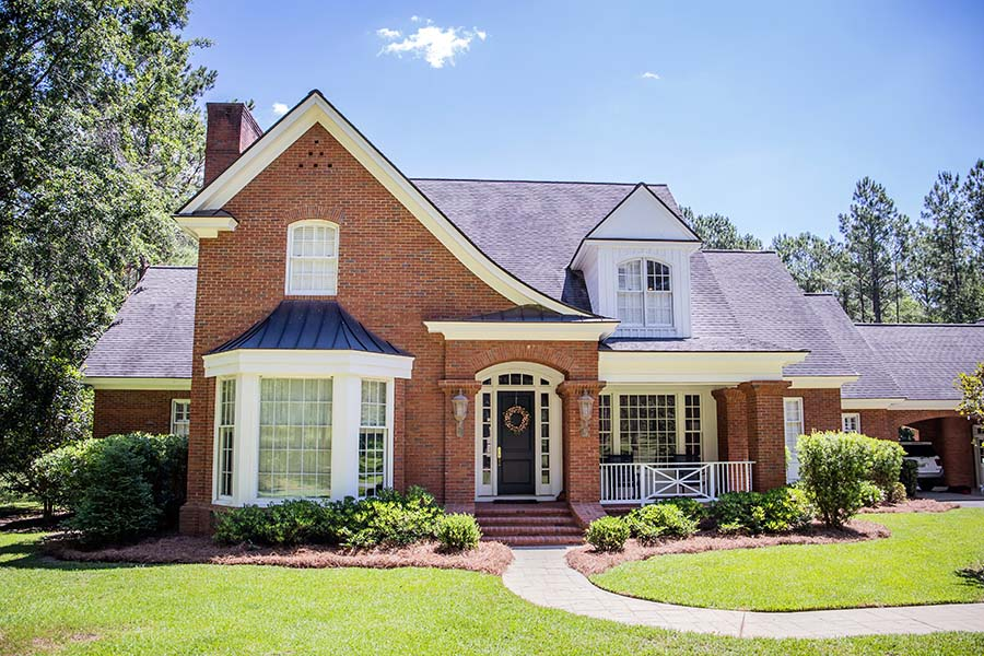 Contact - Exterior Of Large Red Brick Colonial Home